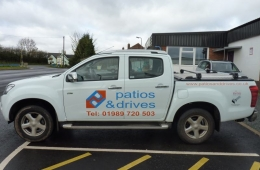 Patios & Drives pickup sign ns side